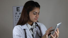 Doctor using a tablet. Young Doctor using a tablet stock footage