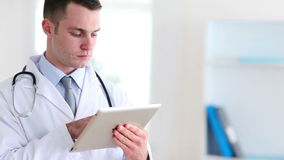Doctor using a tactile tablet