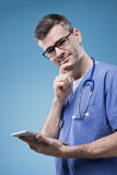 Doctor using a touch screen tablet Stock Photo