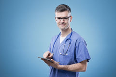 Doctor using a touch screen tablet Royalty Free Stock Photo