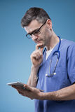 Doctor using a touch screen tablet Royalty Free Stock Photography