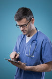 Doctor using a touch screen tablet Stock Image