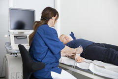 Doctor Using Ultrasound Probe On Man's Hand In Hospital Stock Image