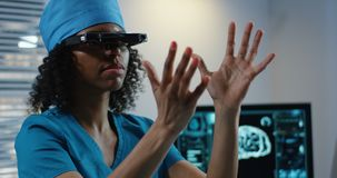 Doctor using VR headset during discussing diagnosis. Medium shot of Doctor using VR headset during discussing diagnosis stock image
