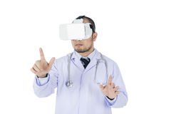 Doctor using a VR headset to check medical information. Isolated on whtie background Royalty Free Stock Photo