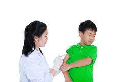 Doctor vaccinating boy`s arm. Asian boy worry about vaccine syri stock photo