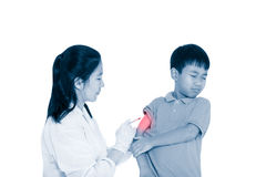 Doctor vaccinating boy`s arm. Asian boy worry about vaccine syri royalty free stock image