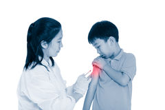 Doctor vaccinating boy`s arm. Asian boy worry about vaccine syri royalty free stock images