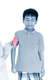 Doctor vaccinating boy`s arm. Human health care and medical conc stock image