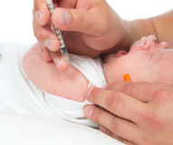 Doctor vaccinating child baby flu injection shot i Stock Photography