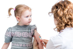 Doctor vaccinating child girl isolated Royalty Free Stock Photo