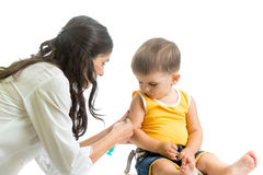 Doctor vaccinating  kid boy isolated Stock Photo