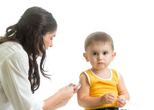 Doctor vaccinating  kid boy isolated Royalty Free Stock Photo
