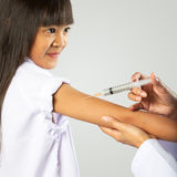 Doctor vaccinating little girl Royalty Free Stock Image