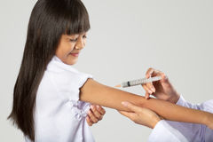 Doctor vaccinating little girl Royalty Free Stock Images