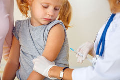 Doctor vaccinating small girl Royalty Free Stock Photography