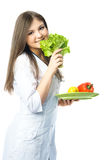 Doctor with vegetables Royalty Free Stock Image