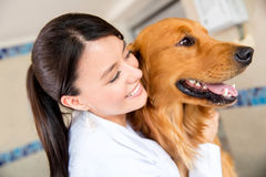 Doctor hugging a dog Stock Image