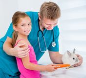 Doctor of veterenarii and little girl with rabbit Stock Photo