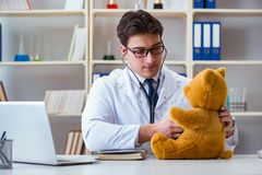 Doctor veterinary pediatrician holding an examination in the off Stock Image