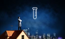 Doctor and vial symbol royalty free stock image