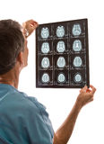 Doctor Viewing MRI Scans Stock Image