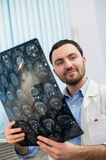 Doctor viewing mri x-ray of brain in office Royalty Free Stock Photography