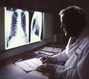 Doctor viewing xray Stock Images