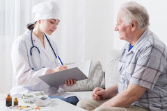 Doctor visit to elderly patient Stock Photography