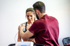 Doctor visit. S a young girl with electrocardiogram during cyclette Royalty Free Stock Photography