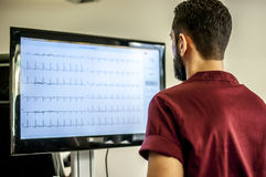 Doctor visit. S a young girl with electrocardiogram during cyclette Royalty Free Stock Images