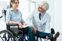 Doctor visiting an invalid patient Stock Photo