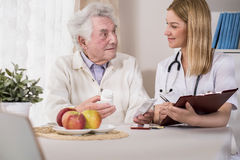 Doctor visiting patient at home Royalty Free Stock Image