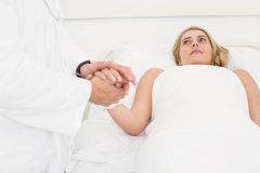 Doctor visiting patient in hospital Stock Image