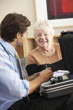 Doctor visiting senior woman at home Stock Photo
