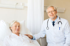 Doctor visiting senior woman at hospital ward Royalty Free Stock Image