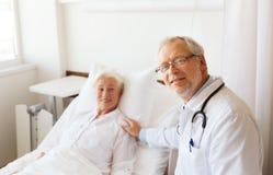 Doctor visiting senior woman at hospital ward Royalty Free Stock Photography