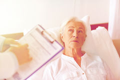 Doctor visiting senior woman patient at hospital Royalty Free Stock Image