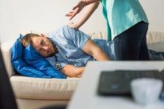 Doctor waking sleeping medic Royalty Free Stock Photos