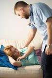 Doctor waking sleeping medic Royalty Free Stock Image