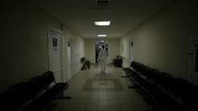 Doctor walking at hospital corridor stock video