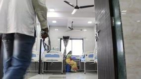 Doctor walking toward patient stock video