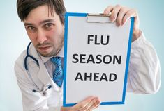 Doctor is warning against flu season ahead. View from top Royalty Free Stock Photo