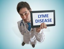 Doctor is warning against Lyme disease caused by ticks Royalty Free Stock Photo