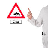Doctor warns of Zika. Doctor warns of dengue next to a sign with a mosquito and the text Zika royalty free stock photos