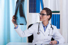 The doctor watches chest X-ray Stock Image