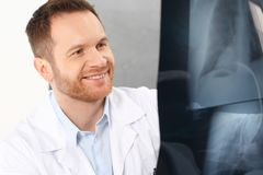 The doctor is watching an X-ray. A doctor in a doctor`s office royalty free stock photo