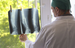 Doctor watching x-ray pictures royalty free stock photos