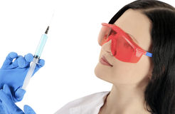 Doctor wearing a glasses with syringe Royalty Free Stock Images