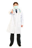 Doctor wearing mask and showing thumbs up gesture Royalty Free Stock Image